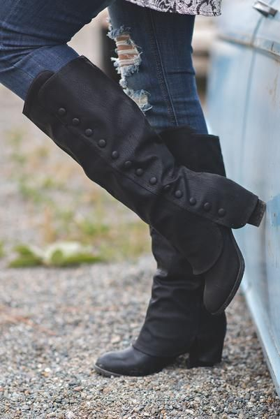 These Sexy Black Boots Will Be Pushing All the Right Buttons Finish off any fall look with these sleek and sexy black staple boots. With a fold over style, emb