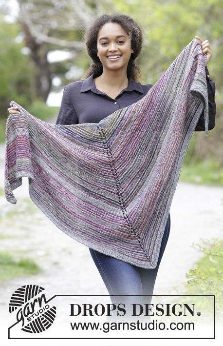 The set consists of: Knitted shawl and gloves with garter stitch and stripes.  The set is worked in DROPS Fabel. Free pattern by DROPS Design.