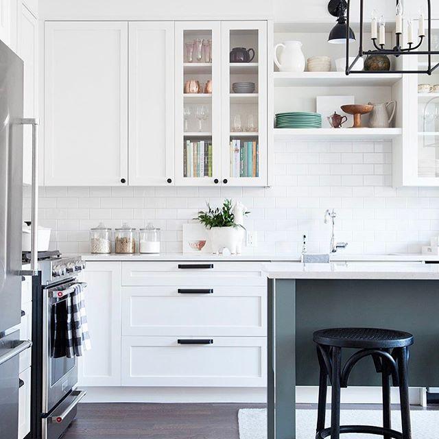 Bright white and modern kitchen design with dark details - Vanessa Francis Design. Featured on Design Sponge