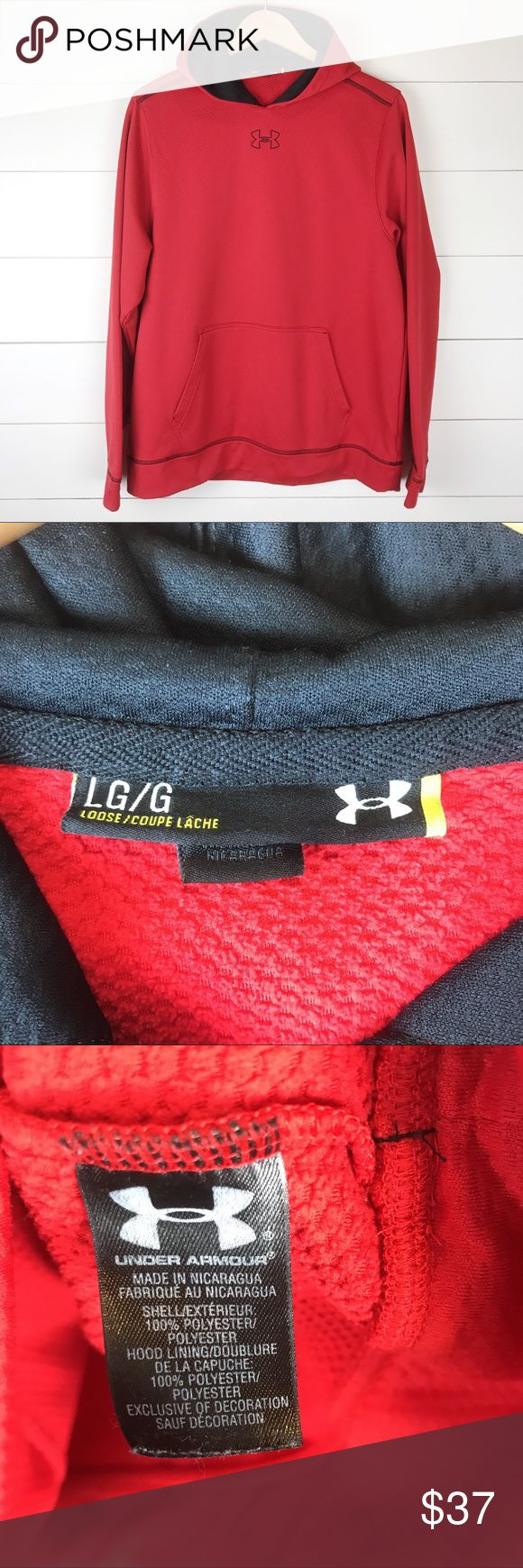 """Under Armour L Pullover Hoodie Logo Pocket Spell Awesome Under Armour pullover hoodie.  Great logo on front and spellout on hood.  Bright red and black in size large. Missing string in hood.  MEASUREMENTS  Underarm to Underarm 23""""  Underarm to End of Sleeve 21 1/2"""" Length 28""""   A2 Under Armour Shirts Sweatshirts & Hoodies"""