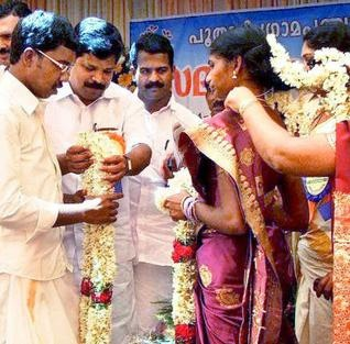 """""""Mass marriage sans dowry"""" Workers under the MGNREGS organise a mass marriage without dowry at Poothadi grama panchayat in Wayanad district, Kerala."""