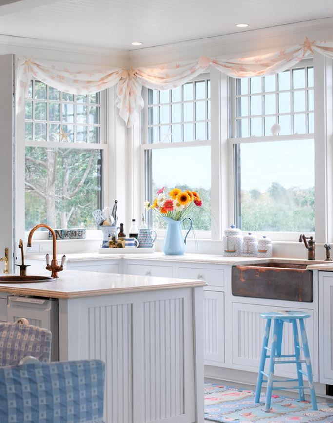 This #BeachCottage #Kitchen is so bright and cheerful. Love the contrast of the rustic sink against the crisp white. #CapeCodRealEstate www.capecodrelo.com