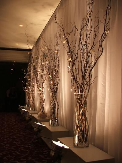 I like this idea with whatever is locally available. Good for Winter wedding. centerpieces or accent decor