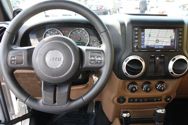 2012 Silver Jeep Wrangler Sahara http://www.iseecars.com/used-cars/used-jeep-wrangler-for-sale
