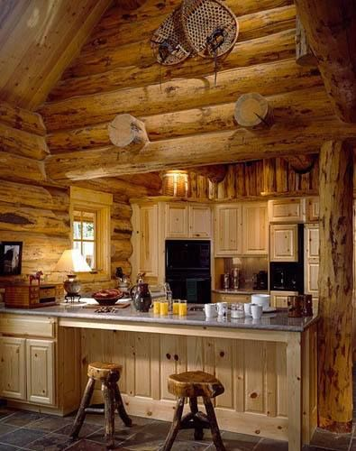 The interior of this cabin keeps things as authentic as possible, with even the kitchen stools matching the theme of the room.