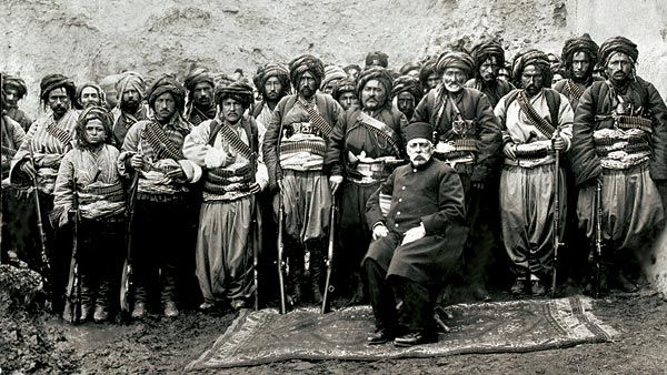 """Turkish basi bozuk in Bulgaria 1877-78. Bashi-bazouk or bashibazouk (Turkish literally """"damaged head"""", meaning """"free headed"""", """"leaderless"""", """"disorderly"""") was an irregular soldier of the Ottoman army. Particularly noted for their lack of discipline."""