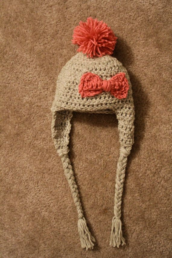 cute crochet hat with a bow and a pom pom