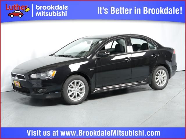New 2015 Mitsubishi Lancer For Sale in Brooklyn Center MN at Luther Brookdale Mitsubishi dealer Minneapolis. Mitsubishi sedan for sale Minnesota. Twin Cities. Black sedan 5 speed manual for sale Minneapolis.