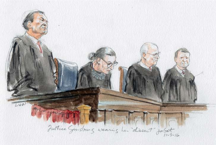 """Ginsburg wore the embellished collar ruffle meant to show disagreement and stray from the majority opinion on decisions before the high court. But there were no court decisions slated to go out on Wednesday. """"I can't imagine what this place would be — I can't imagine what the country would be — with Donald Trump as our president…For the country, it could be four years. For the court, it could be — I don't even want to contemplate that,"""" she told the New York Times in July. Image: SCOTUS"""