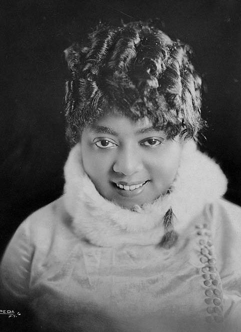 """Mamie Smith (May 26,1883-Sept16,1946) was a singer, pianist and actress. She entered blues history by being the first African American artist to make vocal blues recordings. On August 10, 1920 Smith recorded """"Crazy Blues"""" and """"It's Right Here For You,""""on Okeh Records. The record sold a million copies in less than a year. """"Crazy Blues"""",was inducted into the Grammy Hall of Fame in 1994 In 2005, was selected for permanent preservation in the National Recording Registry at the Library of…"""