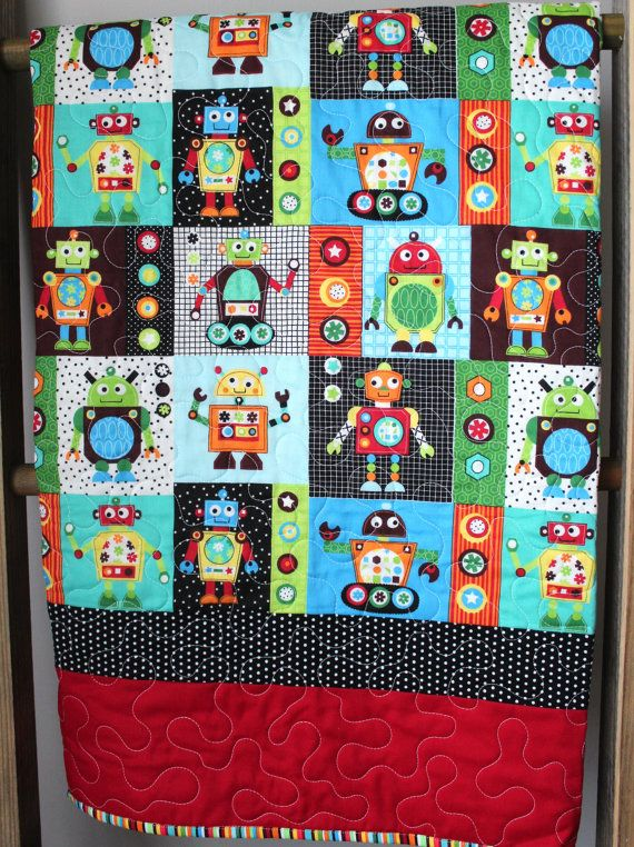 Modern Baby Boy Quilt-Robot Nursery Bedding-Toddler Quilt This modern boy quilt features a fun print of multicolored robots and a double border of solid red and black and white polka dots. It is backed in a coordinating grey and white polka dot print. The binding on the edge is a fun, multicolored stripe that matches the colors in the robot print. What makes this item great: ♥ It is fully reversible. ♥ The binding is machine stitched to both sides for durability and style. ♥ It is made…