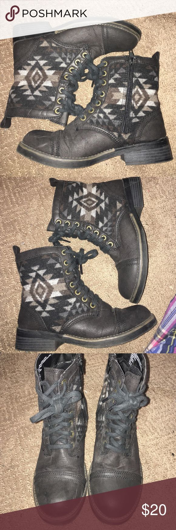 Combat Aztec boots Got these for xmas last year and I honestly don't ever remember wearing them. Maybe once. But the bottoms look like I never left the house 😂 they are from target. Comfy. Mid ankle boot style. Working inner zippers. Lace up as well. Size 7. Distress worn look to them. Colors in the Aztec are black/brown/gray. Actual boot is black. Shoes Ankle Boots & Booties