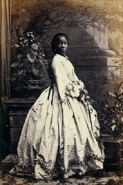 "Lady Sarah Forbes Bonetta Davies (photographed-Camille Silvy,1862) born into a royal West African dynasty, and orphaned in 1848, when five years old, when her parents were killed in a slave-hunting war. In 1850, Sarah was taken to England and presented to Queen Victoria, a ""gift"" from the King of Dahomey. She became the ""Queen's Goddaughter"" and a celebrity known for her extraordinary intelligence. She spent her life between the British royal household and in Africa until her death in 1880."