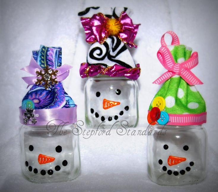 Snowman gift jars made from baby food jars! fill with marshmallows and put in a small gift bag w hot cocoa mix... or fill with cotton balls and make a cute manicure/nail polish gift!