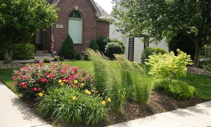 Landscaping With Evergreens And Grasses : Corner landscape installationpanting daylily rose ornamental grass