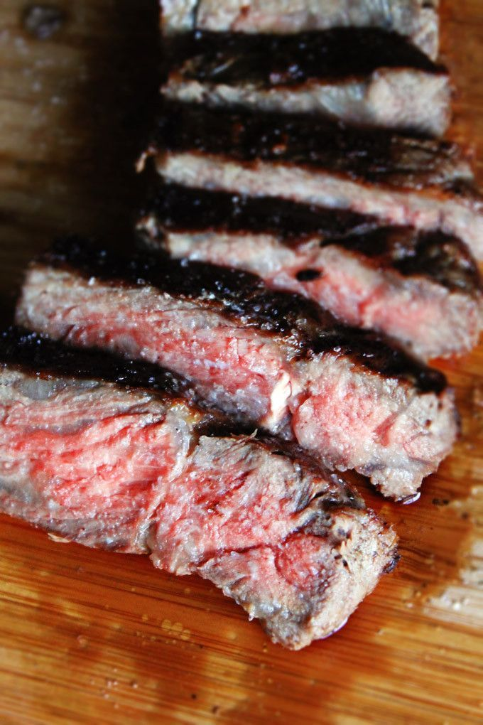 How to cook the perfect medium-rare steak. Seasoned and seared well with a red center.