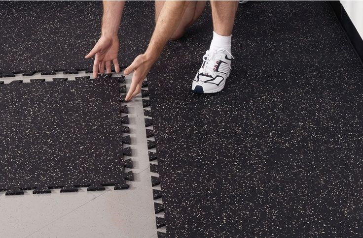 Interlocking rubber tiles are an excellent flooring solution for a home gym. Easy to DIY, this rubber flooring is a popular choice