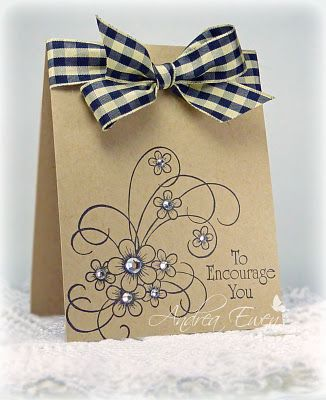 I love ribbon on cards, but never have the nerve to use it myself!! I love the cheerful gingham look against the caramel backing. The stamp is GORGEOUS too.