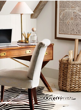 A comfortable chair and wooden desk combination.