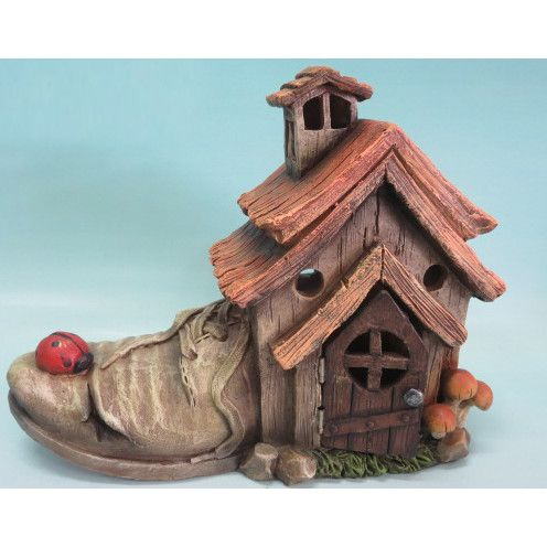 Features:  -Composition: Polyresin.  -Indoor and outdoor use.  Product Type: -Statue.  Color: -Multi-colored.  Style: -Contemporary.  Material: -Resin/Plastic.  Theme: -Fairy Garden. Dimensions:  Over