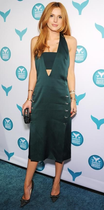 Bella Thorne in a forest green navel-plunging design.