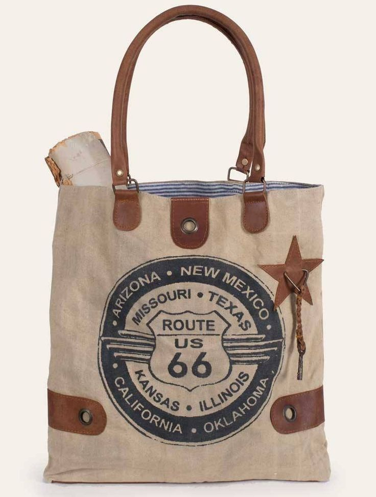 Canvas and leather tote bag. While it may not be called Route 66 anymore, this stretch of highway is an indelible part of American History. Hum along with Nat King Cole singing his famous song while y