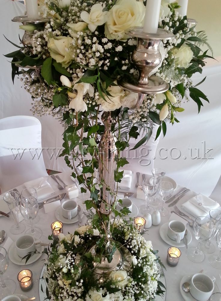 Large m tall silver candelabra with trailing ivy and