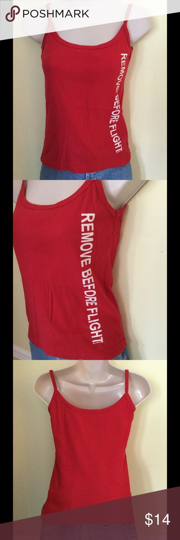 """""""Remove Before Flight"""" red tank top, size small Red tank top with the words """"Remove Before Flight"""" down the side in white lettering.  Size small.  Only worn once. gaziani Tops Tank Tops"""