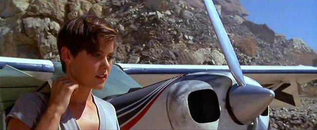 """Carey Lowell - Pam Bouvier     License to Kill was a darker, edgier, more """"realistic"""" Bond, and this reflects on Carey Lowell, too. She doesn't have one of the typical sassy Bond girl names, and her character is a freelance pilot working for the CIA sometimes. But of course even she can't resist the charme of Mr. Bond."""