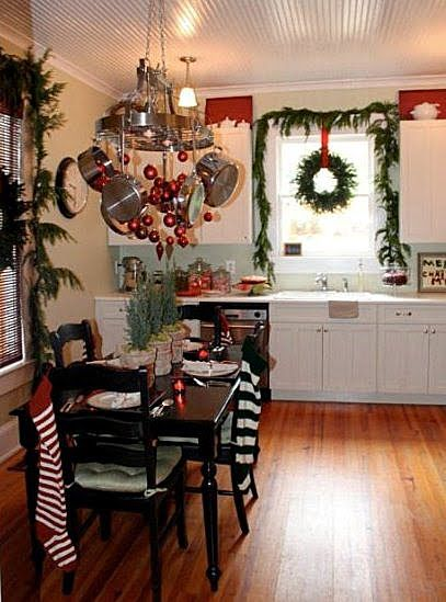 Huh, never really thought about decorating the kitchen. kitchen window garland and wreath.  love this.