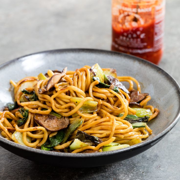 Cooking the noodles without moving them lets them develop a light, flavorful char. shiitake-and-bok-choy-lo-mein
