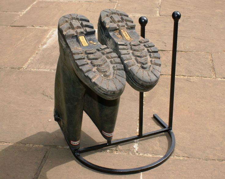This metal wellington boot rack stands to attention and holds four pairs of boots, all neatly in a line. Description from carpetrunners.co.uk. I searched for this on bing.com/images