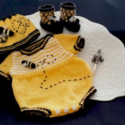 Knitted playsuit called Honey Bee Baby Onesie.  The pattern is for 0 to 2 years old.  See www.tbeecosy.co.za