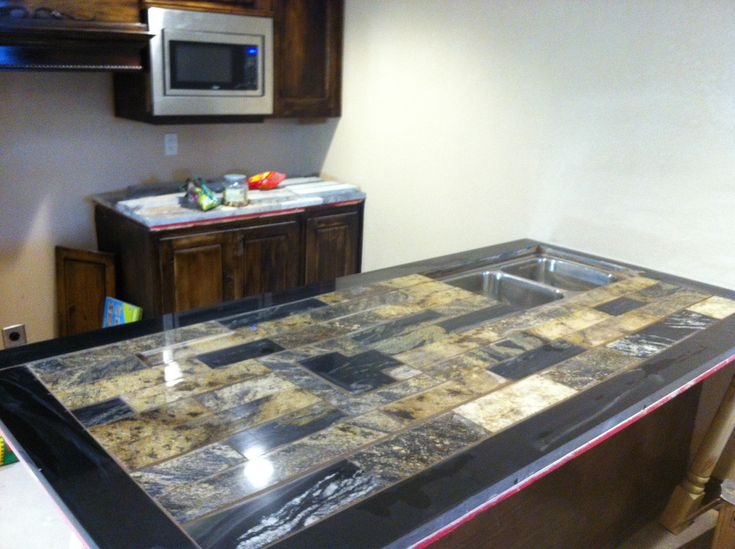 "Granite Remnants: ReStore KC Customer Tony Cardello. I used remnant trim pieces and granite slabs, each of the granite ""bricks"" have been trimmed, re-trimmed and re-polished. to create this unique kitchen island."