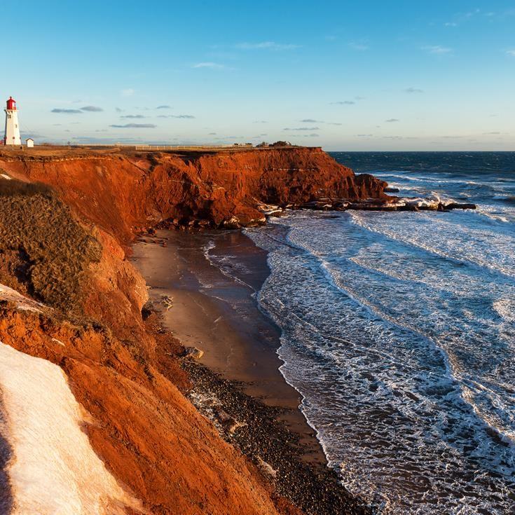 The Anse-a -la-Cabane lighthouse at sunset on Havre Aubert Island