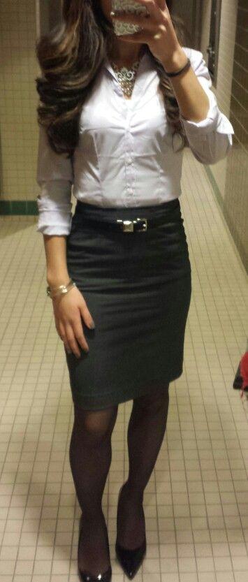 Classic. Black pencil skirt. White button up blouse.