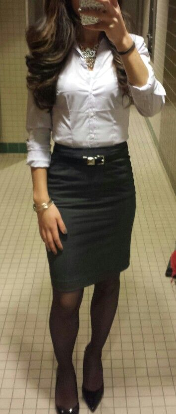 Classic. Black pencil skirt. White button up blouse.