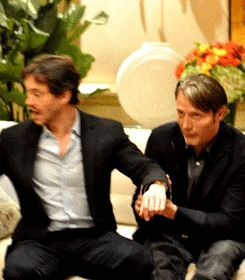 Hugh Dancy and Mads Mikkelsen goofing off at a press event for Hannibal.