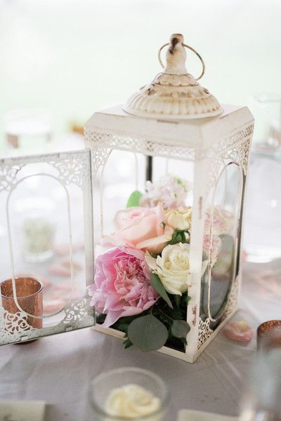 Vintage wedding centerpiece idea - white lanterns filled with pink + cream roses and peonies {Rockhill Studio}