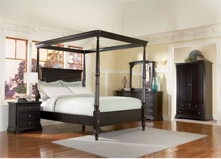 Black Canopy Bed With White Mattress And Black Wooden Wardrobe