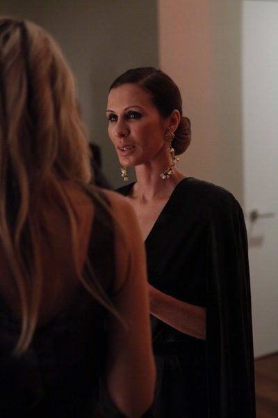 Still of Carole Radziwill. She looks lovely--the drop earrings make the outfit. Also, the chignon. Very elegant.