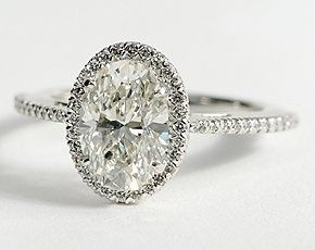Wow-- Oval Halo Diamond Engagement Ring in 14K White Gold - id want this ring exactly because of the skinny band and tiny diamonds around the big one, but Id want it go be a pear shaped instead!!