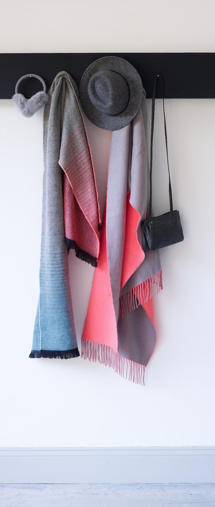 Power up for autumn in our Ombre Striped Scarf. With an ombre striped pattern and a contrasting black fringe, this scarf will instantly inject colour and warmth to your outfit.