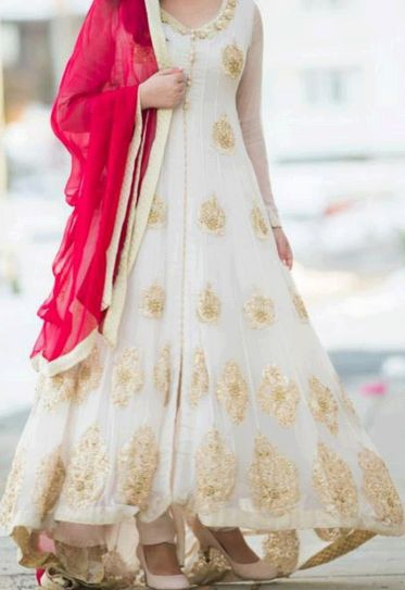 Beautiful white anarkali with Gold and a pop of color.