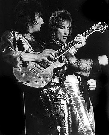 Ron Wood playing guitar...and yes the other gentleman is Rod Stewart