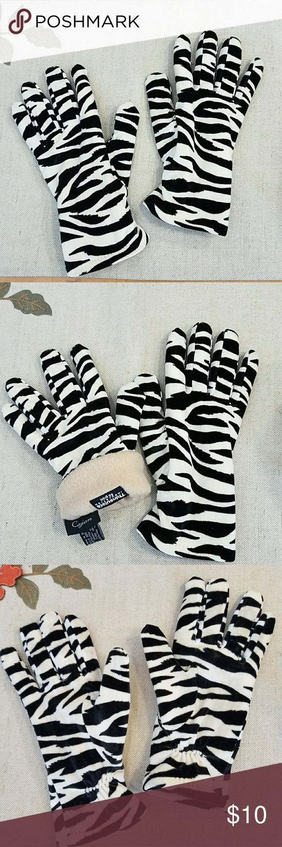 Zebra Print Thinsulate Gloves Velour zebra-print gloves with Thinsulate insulated lining. Gathered at wrists. Tag says OSFA but I think these will fit S-M sizes best. Adorable, soft and warm! Cejon Accessories Gloves & Mittens