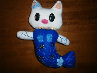 Lia B. Creations: Dark blue Hello Kitty mermaid