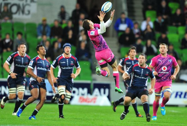 South African Super Rugby Team The Bulls left wing Bjorn Basson (C) leaps for the balls as Melbourne Rebels players close in during the first half of the Super Rugby match in Melbourne on May 4, 2012.