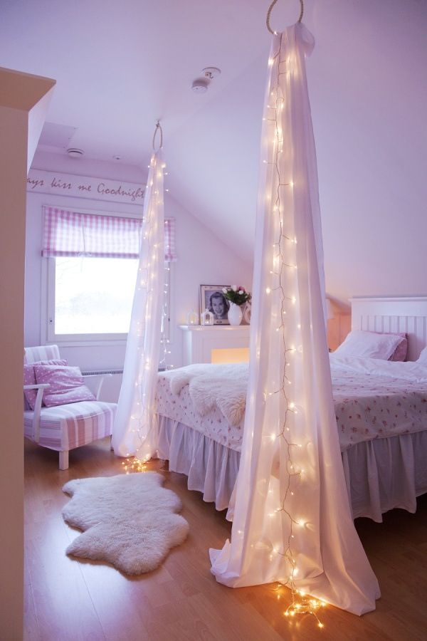 Curtain idea - Fairy lights & shabby chic bedroom. I like this look but wonder if the lights ( run on batteries ) make this a fire hazard ? ... without the lights, just to be extra safe, especially in a Child's bedroom and curtains at the head of the bed as well on a regular height ceiling !!!