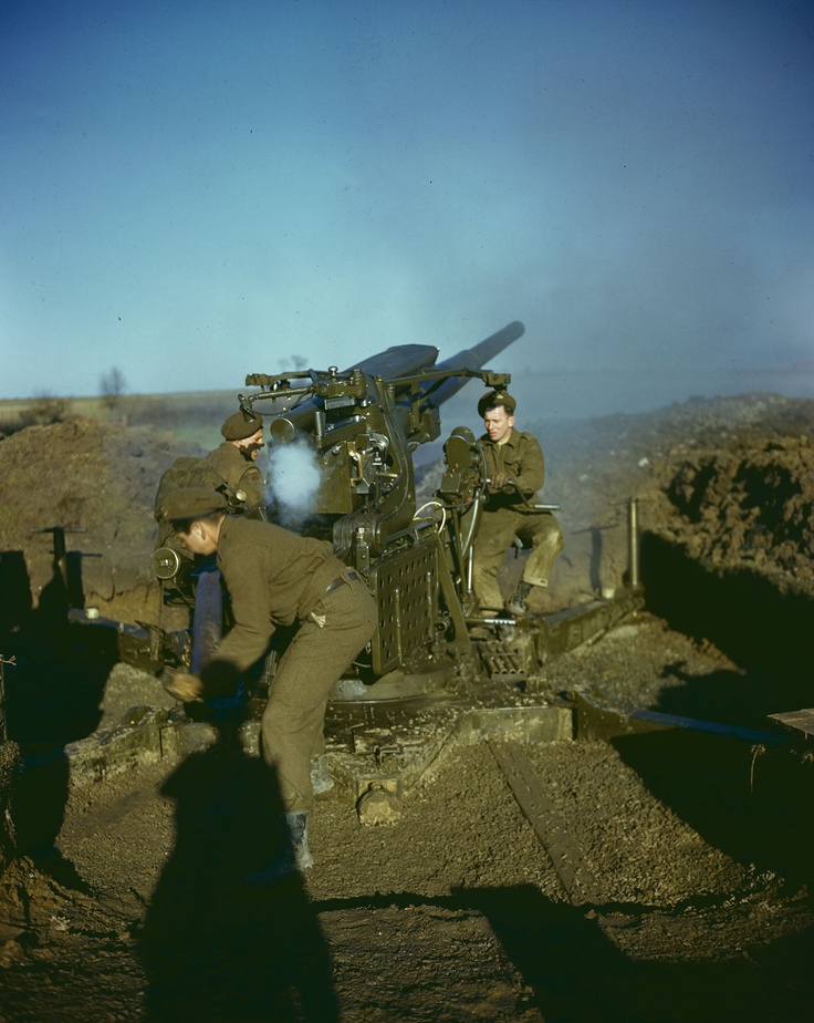 Canadian gunners firing a 94-mm anti-aircraft gun in the vicinity of Dunkirk, France, 1944.